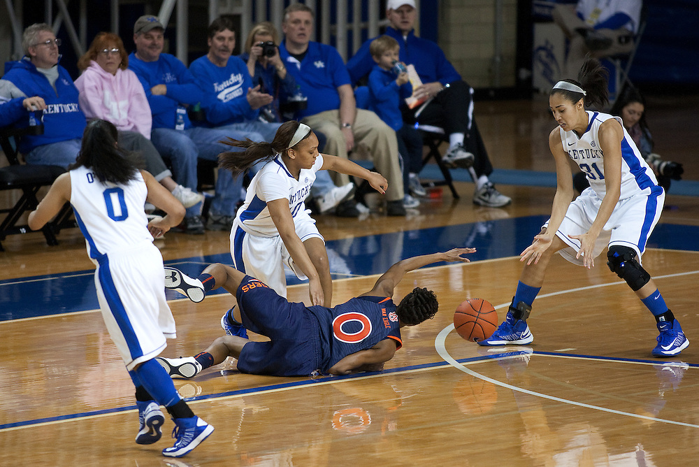 UK guard Bernisha Pinkett, center, causes a loose ball that forward/center Samantha Drake picks up a passes up court in the second half. The University of Kentucky Women hosted Auburn University, Sunday, Jan. 20, 2013 at Memorial Coliseum in Lexington. Photo by Jonathan Palmer