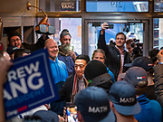 12 DECEMBER 2019 - DES MOINES, IOWA: ANDREW YANG (center) walks through the crowd to the opening of his Ames, IA, campaign office. Yang, an entrepreneur, is running for the Democratic nomination for the US Presidency in 2020. He brought bus tour to Ames, IA, Thursday. Iowa hosts the the first election event of the presidential election cycle. The Iowa Caucuses will be on Feb. 3, 2020.                        PHOTO BY JACK KURTZ