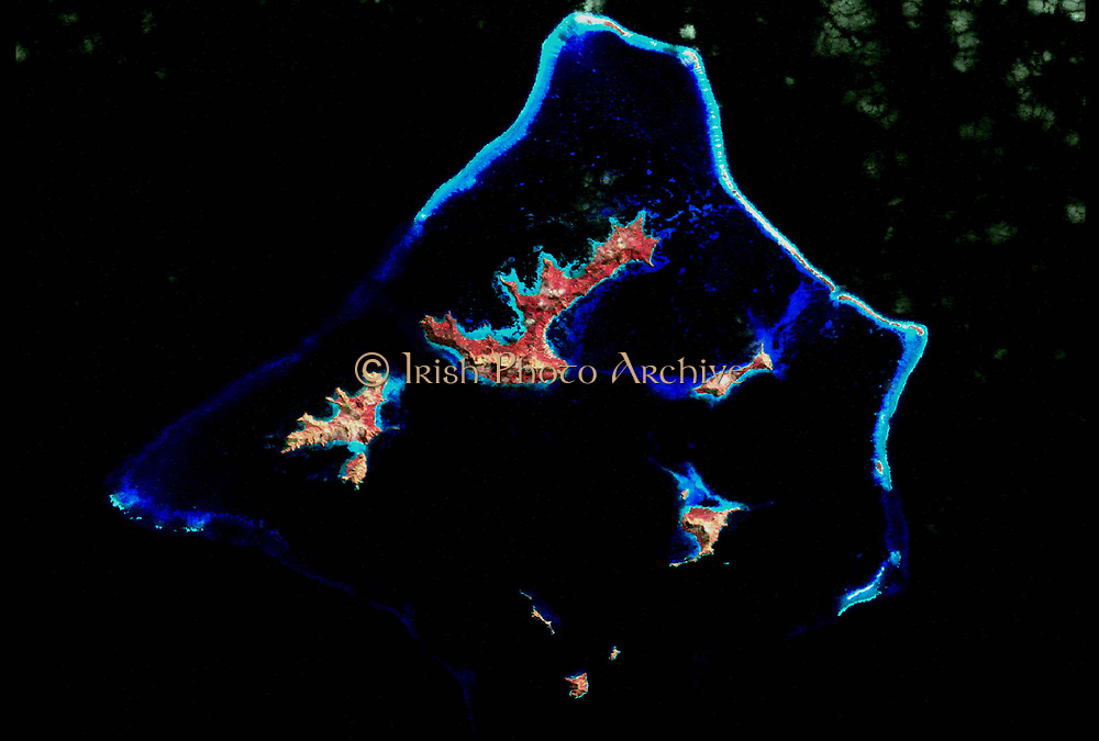 Coral reef photographed by NASA's Landsat 7 satellite. Credit NASA.   Science Geology Oceanography