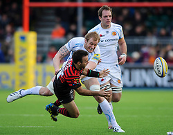 Saracens Scrum-Half (#9) Neil de Kock passes in a tackle during the second half of the match - Photo mandatory by-line: Rogan Thomson/JMP - Tel: Mobile: 07966 386802 16/02/2013 - SPORT - RUGBY - Allianz Park - Barnet. Saracens v Exeter Chiefs - Aviva Premiership. This is the first Premiership match at Saracens new home ground, Allianz Park, and the first time Premiership Rugby has been played on an artificial turf pitch.