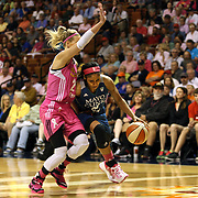 Maya Moore, (right), Minnesota Lynx, drives to the basket defended by Katie Douglas, Connecticut Sun, during the Connecticut Sun Vs Minnesota Lynx, WNBA regular season game at Mohegan Sun Arena, Uncasville, Connecticut, USA. 27th July 2014. Photo Tim Clayton