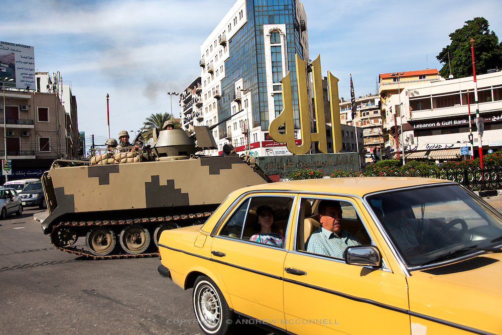 "A Lebanese army tank manoeuvres through a roundabout in which a gold Arabic sign stands which reads, ""Allah,"" in the northern city of Tripoli, Lebanon. Tripoli has seen a rise in extremist elements over the past few years with Salafists playing an increased military role there."