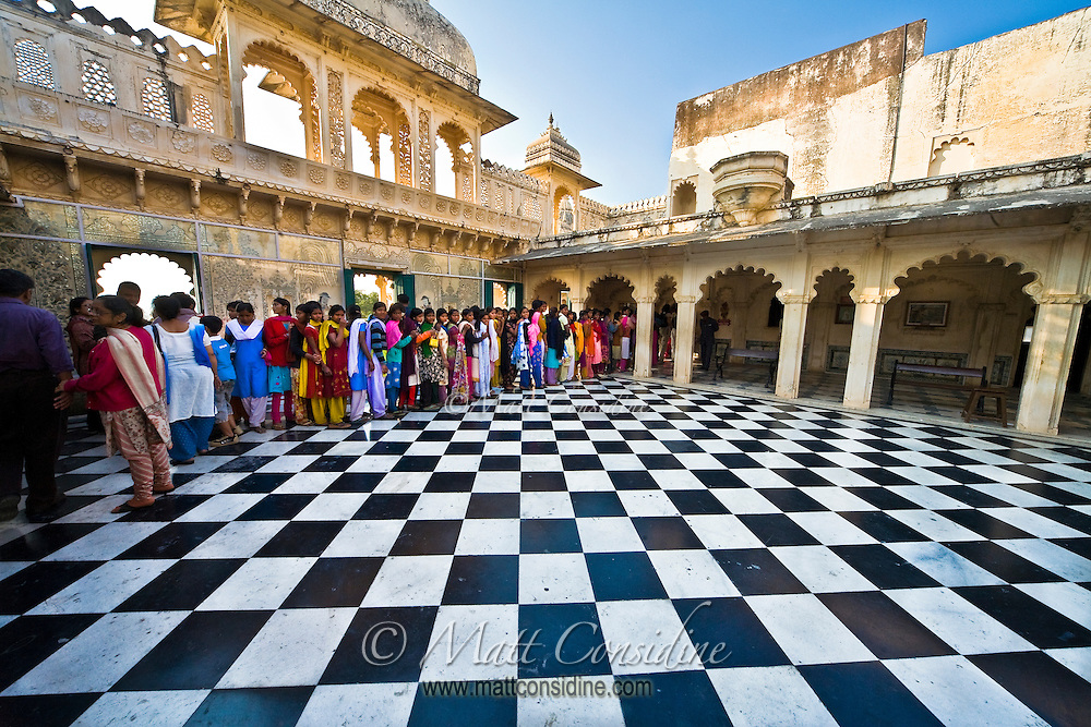 A colorful group of women queue to see the old palace.<br /> (Photo by Matt Considine - Images of Asia Collection)