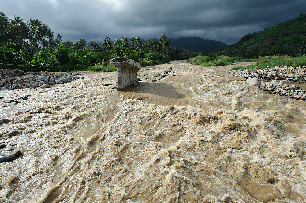 Bridge destroyed by a flooding river, Gorontalo, Sulawesi, Indonesia.