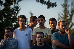People participate in a joint funeral for the three Israeli teens at a cemetery in Modi'in near Jerusalem, on July 1, 2014. The three Israeli teens whose bodies were found Monday evening were brought to rest side by side on Tuesday at a joint funeral held in Modi'in near Jerusalem. Tens of thousands of people participated in the funeral, including Prime Minister Benjamin Netanyahu and President Shimon Peres, who eulogized the three, whose caskets were wrapped with Israeli flags. EXPA Pictures © 2014, PhotoCredit: EXPA/ Photoshot/ Li Rui<br /> <br /> *****ATTENTION - for AUT, SLO, CRO, SRB, BIH, MAZ only*****