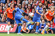 Adebayo Akinfenwa of AFC Wimbledon shoots during the Sky Bet League 2 match at Kenilworth Road, Luton<br /> Picture by David Horn/Focus Images Ltd +44 7545 970036<br /> 16/08/2014