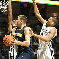 Michigan's Mitch McGary (4) drives to the basket during the second half of an NCAA college basketball game in University Park, Pa., Wednesday, Feb. 27, 2013.