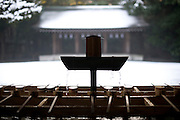 Snow covers the ground in front of the temizuya purification pavilion at Meiji Jingu Shrine after the year's first snowfall in Tokyo, Japan on 02 Feb. 2010.