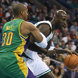 Feb 10, 2010; New Orleans, LA, USA; Boston Celtics forward Kevin Garnett (5) drives past New Orleans Hornets forward David West (30) during the first quarter at the New Orleans Arena. Mandatory Credit: Derick E. Hingle-US PRESSWIRE