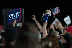 October 26, 2016 - Kinston, North Carolina, United States - A Trump supporter holds up a Hillary Clinton doll with a noose around it's neck, during a campaign event at the Kinston Jet Center on October 26, 2016 in Kinston, North Carolina  (Credit Image: © Zach D Roberts/NurPhoto via ZUMA Press)