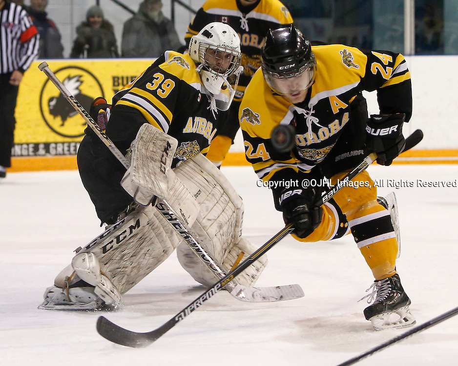 AURORA, ON - Mar 4, 2015 : Ontario Junior Hockey League game action between the Aurora Tigers and the Newmarket Hurricanes.  Game four of the best of seven series, Andy Munroe #39 keeps an eye on the puck in overtime.<br /> (Photo by Brian Watts / OJHL Images)