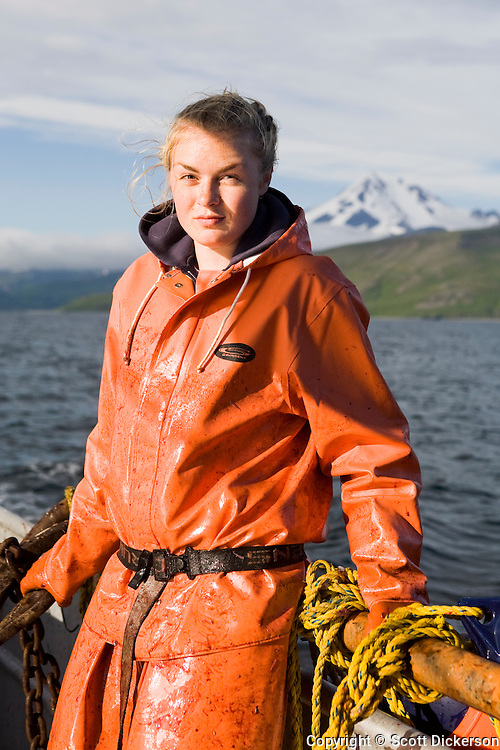 Emma Teal Laukitis waiting patiently for another halibut to clean while commercial longline fishing in the Aleutian Islands, Alaska.