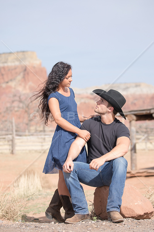 cowboy and girl looking at one another