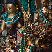 Asian work of art (Tibetan/ Japanese/Chinese )  Buddhas and Tibetan Jewelry in Tibetan Handicraft, New York store window in Greenwich Village, NYC