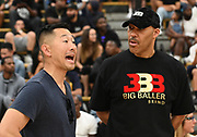 Former Chino Hills head basketball coach Steve Baik (left) talks with LaVar Ball (right) during a Drew League basketball game, Saturday, June 8, 2019, in Los Angeles.  (Dylan Stewart/Image of Sport)