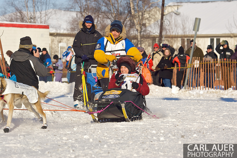March 7th, 2009:  Anchorage, Alaska - Bjornar Andersen from Elverum, Norway make the turn from 4th Avenue onto Cordova during the Start of the 2009 Iditarod Sled Dog Race.
