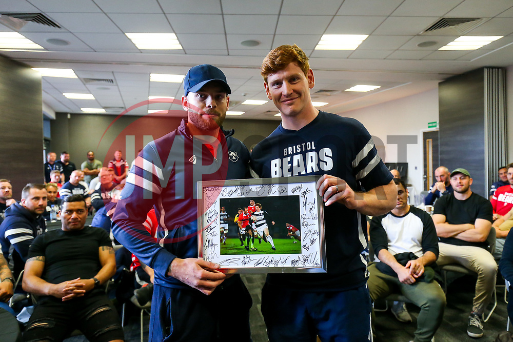 Ryan Edwards thanks Jack Tovey as the Bristol Bears squad gather to make presentations to departing players after the Bristol Bears Team Run ahead of the Sale Sharks Game - Rogan/JMP - 02/05/2019 - RUGBY UNION - Ashton Gate Stadium - Bristol, England - Bristol Bears v Sale Sharks - Gallagher Premiership Rugby.
