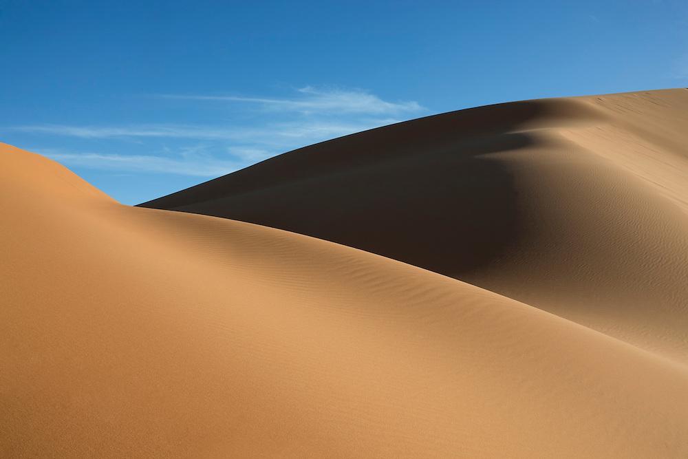 Sahara desert sand dunes with clear blue sky at Erg Chebbi, Merzouga, Morocco.