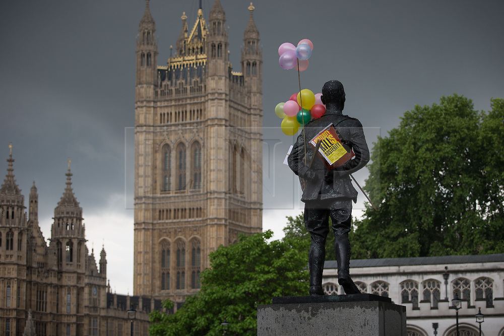 © Licensed to London News Pictures . 20/06/2015 . London , UK . Statue of Ian Smuts in Parliament Square . Tens of thousands of people march from the Bank of England to Parliament , to protest economic austerity in Britain . Photo credit: Joel Goodman/LNP