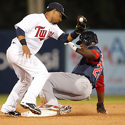 February 27, 2011; Fort Myers, FL, USA; Boston Red Sox center fielder Mike Cameron (23) steals second base past Minnesota Twins second baseman Alexi Casilla (12) during a spring training exhibition game at Hammond Stadium.  Mandatory Credit: Derick E. Hingle