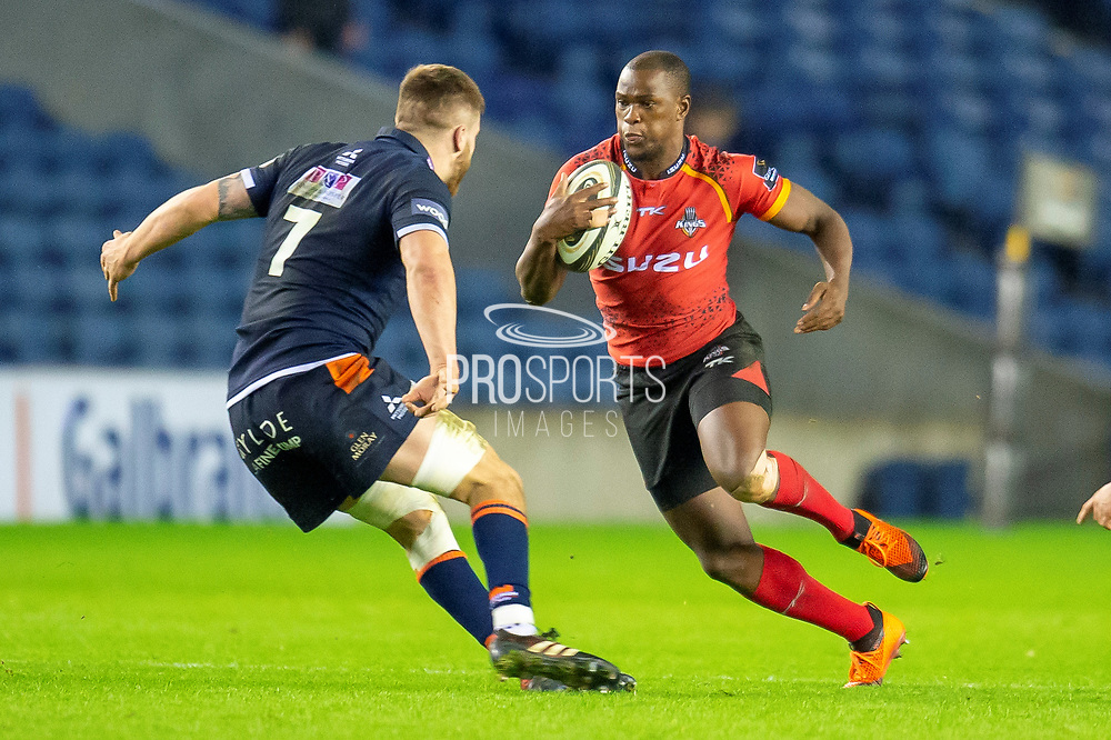 Michael Makase (#14) of Isuzu Southern Kings attempts to sidestep Luke Crosbie (#7) of Edinburgh Rugby during the Guinness Pro 14 2018_19 rugby match between Edinburgh Rugby and Isuzu Southern Kings at the BT Murrayfield Stadium, Edinburgh, Scotland on 5 January 2019.