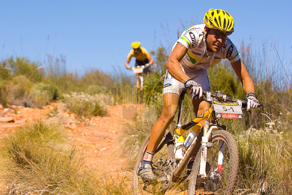 WESTERN CAPE, SOUTH AFRICA -  30 March 2008, Kevin Evans descends during stage two of the 2008 Absa Cape Epic Mountain Bike stage race from Saasveld Campus Nelson Mandela Metropolitan University in George to Calitzdorp Spa, Calitzdorp in the Western Cape, South Africa..Photo by Sven Martin/SPORTZPICS