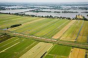 Nederland, Zuid-Holland, Groene Hart, 04-07-2006; Polder Stein (ten Oosten van Gouda): dubbeldeks trein onderweg tussen Gouda en Woerden; in de achtergrond de Reeuwijksche Plassen; veenweidegebied, waterhuishouding, sloten, verkaveling, milieu, planologie, openbaar vervoer, ns, nederlandse spoorwegen, reizigers                        luchtfoto (toeslag); aerial photo (additional fee required); .foto Siebe Swart / photo Siebe Swart