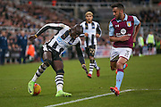 Newcastle United midfielder Mohamed Diame (15) turns Aston Villa defender Neil Taylor (3)  during the EFL Sky Bet Championship match between Newcastle United and Aston Villa at St. James's Park, Newcastle, England on 20 February 2017. Photo by Simon Davies.
