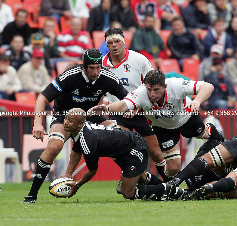 Stormers scrumhalf Bolla Conradie with Adri Badenhorst  clear the ball with Cats Jannes Labuschagnein the rear during the opening round of the 2006 Super 14 rugby union match between the Cats and the Stormers at Ellis Park, Johannesburg, South Africa on 11 February 2006. The Stormers won 23-12. Photo: Africa Visuals/PHOTOSPORT.  #NO AGENTS# NZ USE ONLY#