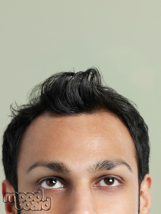 Mid adult man with messy hair close-up of head high section