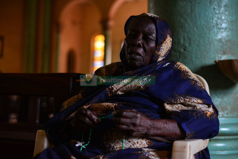 July 4, 2017 - Wau, Wau, South Sudan - A South Sudanese elderly IDP woman   prays at the St. Mary Help Christian Cathedral during the daily morning service led by Father Marko Mangu, who is responsible for the diocese covering the town of Wau.Since clashes between rebels and government forces broke out last year, the churchreceived nearly 22 thousand refugees, mostly  farmers who ran from Dinka tribal militias from the northern areas of War-Awar. (Credit Image: © Miguel Juarez Lugo via ZUMA Wire)