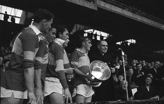 Kerry captain T. Hanlon calls for three cheers after receiving the cup from Rev. Dr. Morris, Archbishop of Cashel after the All Ireland Minor Gaelic Football Final Kerry v. Westmeath in Croke Park on the 22nd September 1963.
