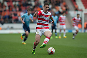 Doncaster Rovers Midfielder Tommy Rowe (Captain) (10) on the attack during the EFL Sky Bet League 2 match between Doncaster Rovers and Blackpool at the Keepmoat Stadium, Doncaster, England on 17 April 2017. Photo by Craig Zadoroznyj.