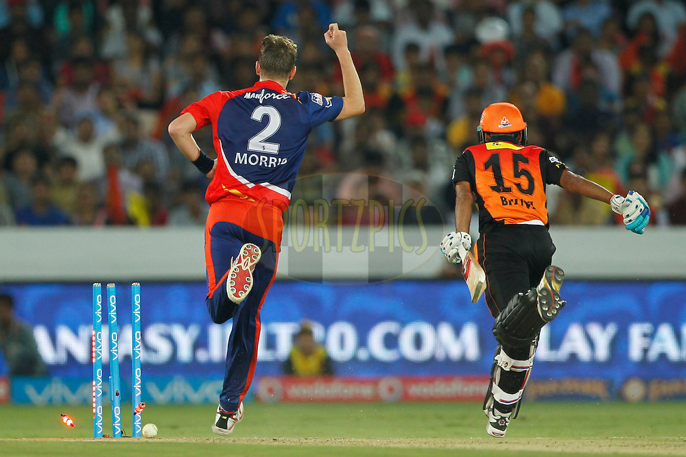 Bhuvneshwar Kumar of Sunrisers Hyderabad runout by Christopher Morris of Delhi Daredevils during match 42 of the Vivo IPL 2016 (Indian Premier League ) between the Sunrisers Hyderabad and the Delhi Daredevils held at the Rajiv Gandhi Intl. Cricket Stadium, Hyderabad on the 12th May 2016<br /> <br /> Photo by Deepak Malik / IPL/ SPORTZPICS