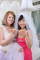 Bride and friend Drinking Cocktails at Bridal Shower