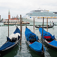 VENICE, ITALY - MAY 06:  The new flagship of Costa Cruises Fascinosa sails in St Mark's Basin in front of a row of moored Gondolas on its madien voyage on May 6, 2012 in Venice, Italy. Costa Cruise announced yesterday that new safety systems are installed to avoid tragedies like the one island of Giglio, which saw the Costa Concordia sink with the loss of 34 lives.  (Photo by Marco Secchi/Getty Images)