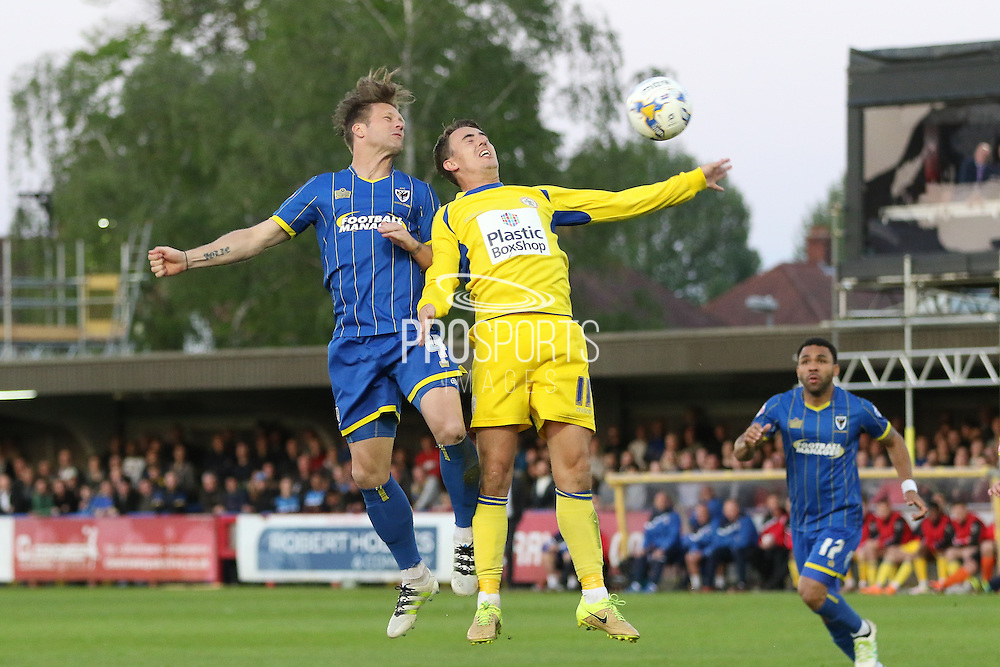 Dannie Bulman midfielder of AFC Wimbledon (4) and Sean McConville midfielder Accrington Stanley (11) in an ariel battle during  the Sky Bet League 2 Play-Off first leg match between AFC Wimbledon and Accrington Stanley at the Cherry Red Records Stadium, Kingston, England on 14 May 2016. Photo by Stuart Butcher.
