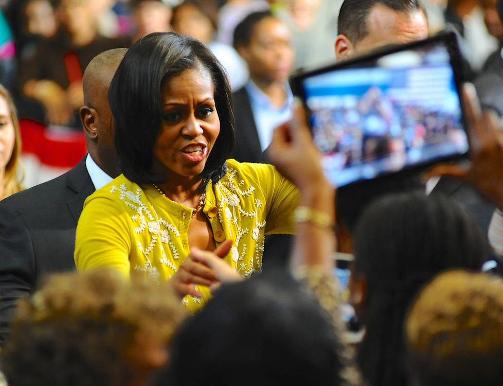 LAURA FONG |  First Lady Michelle Obama greets a crowd of 2,000 at Cuyahoga Community College in Cleveland. Mrs. Obama reminded supporters to get out and vote.