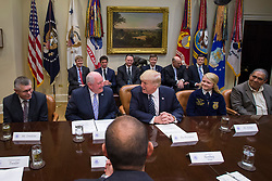 April 25, 2017 - Washington, DC, United States of America - U.S President Donald Trump talks with Agriculture Secretary Sonny Perdue, left, during a farmers roundtable in the Roosevelt Room of the White House April 25, 2017 in Washington, D.C. (Credit Image: © Preston Keres/Planet Pix via ZUMA Wire)