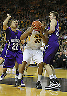 January 12 2010: Iowa Hawkeyes forward Jarryd Cole (50) tries to drive between Northwestern Wildcats guard Michael Thompson (22) and forward John Shurna (24) during the first half of an NCAA college basketball game at Carver-Hawkeye Arena in Iowa City, Iowa on January 12, 2010. Northwestern defeated Iowa 90-71.