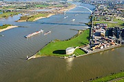 Nederland, Gelderland, Nijmegen, 24-10-2013. Rivier de Waal met ingang Maas-Waalkanaal met verkeerspost van Rijkswaterstaat. De bruggen De Snelbinder en de Oversteek boven in beeld.<br /> <br /> The river Waal near Nijmegen  (central Netherlands)  , near the port. The building is the Traffic Control Centre of Department of Public Works.  Bridges of Nijmegen.<br /> A push-towing ship and a containership on the river.<br /> <br /> luchtfoto (toeslag op standaard tarieven);<br /> aerial photo (additional fee required);<br /> copyright foto/photo Siebe Swart.