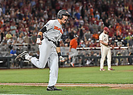 Outfielder Trevor Larnach #11 of the Oregon State Beavers reacts after hitting a two run home run to give the Beavers a 5-3 lead in the ninth inning against the Arkansas Razorbacks during game two of the College World Series Championship Series at TD Ameritrade Park in Omaha, Nebraska.