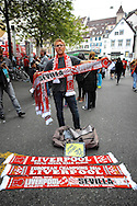 A vendor sells souvenir scarves in a city square in Basel pictured ahead of the UEFA Europa League Final at St. Jakob-Park, Basel<br /> Picture by Kristian Kane/Focus Images Ltd 07814482222<br /> 18/05/2016
