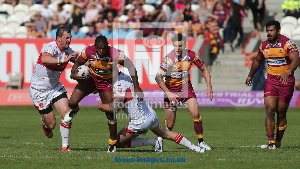 Jamie Peacock of Hull Kingston Rovers tackle Michael Lawrence (C) of Huddersfield Giants during the Super 8s Qualifiers match at the KC Lightstream Stadium, Kingston upon Hull<br /> Picture by Stephen Gaunt/Focus Images Ltd +447904 833202<br /> 24/09/2016