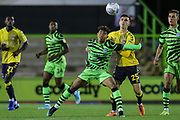 Forest Green Rovers Vaughn Covil(41)  holds off Coventry City's Zain Westbrooke(25) during the Leasing.com EFL Trophy match between Forest Green Rovers and Coventry City at the New Lawn, Forest Green, United Kingdom on 8 October 2019.