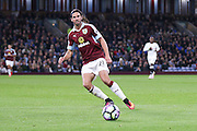 Burnley midfielder George Boyd (21)  lays the ball off  during the Premier League match between Burnley and Watford at Turf Moor, Burnley, England on 26 September 2016. Photo by Simon Davies.