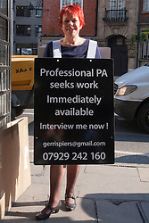 London May 16th 2014. Unemployed PA Gerri Spiers stands outside London Bridge station hoping to attract the opportunity of an interview in what is seen by many to be a difficult environment for job seekers.