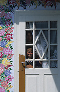Poland . Zalipie - The women of the small village of zalipie (south of poland) are painting on the walls of their houses.. these women artist are following an old but vanishing tradition. Zalipie Poland / les femmes du village de zalipie dans le sud de la pologne décorent leur maisons de peintures florales et autres motifs. Ancienne tradition