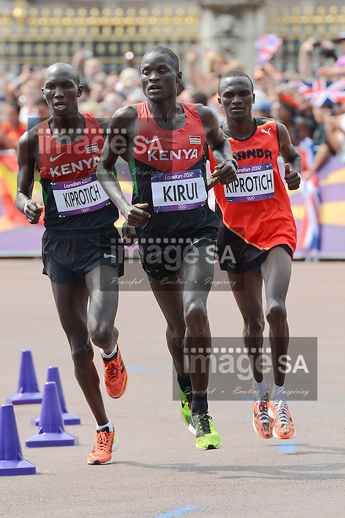LONDON, ENGLAND - AUGUST 12, Wilson Kipsang Kiprotich, Abel Kirui of Kenya and Stephen Kiprotich of Uganda run past Buckingham Palace during the men's marathon in The Mall, on August 12, 2012 in London, England.Photo by Roger Sedres / Gallo Images