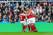 Granit Xhaka (#34) of Arsenal celebrates Arsenal's first goal (0-1) with Arsenal team mates during the Premier League match between Newcastle United and Arsenal at St. James's Park, Newcastle, England on 15 September 2018.